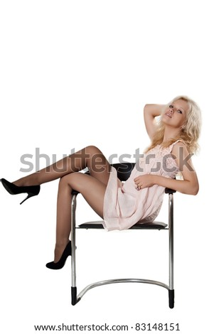 Young happy woman sitting on a armchair, on a white background
