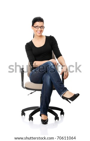 Young happy woman sitting on a wheel  chair, isolated over a white background