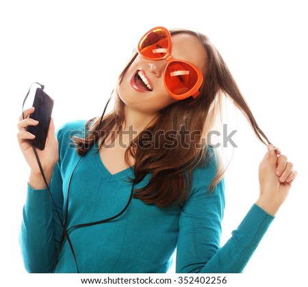 Young happy woman with headphones listening music over white background #352402256