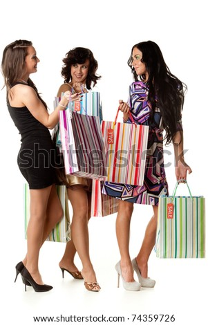 Young happy women with shopping bags  on a white background. Sale.