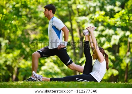 Shutterstock young health couple doing stretching exercise relaxing and warm up after jogging and running in park