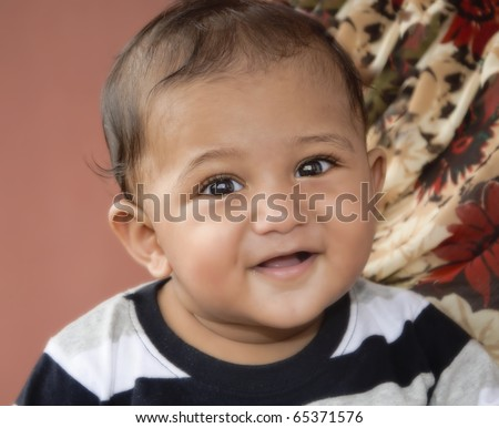 Young health Indian origin Asian toddler smiling at the camera
