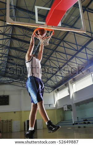 young healthy man play basketball game indoor in gym