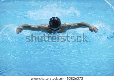young healthy man with muscular body in swimming pool and representing healthy and recreation concept
