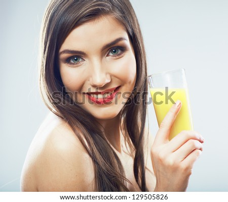 Young healthy woman hold juice glass . isolated