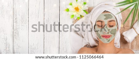 Young healthy woman in spa making treatments and face mask. #1125066464