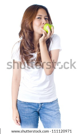 Young healthy woman kissing green apple on white background