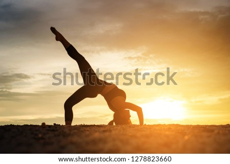 Young healthy woman practicing yoga on the beach exercise at sunset time. healthy concept. #1278823660