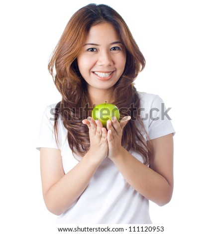 Young healthy woman smiling and holding green apple on white background