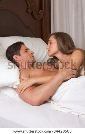 young heterosexual couple in bed