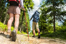 Young hikers walking with trekking poles