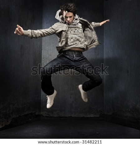 Young hip-hop dancer over a grunge wall
