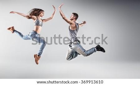 Young hip hop dancers, on studio background