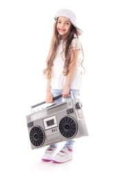 Young hip hop girl listening music on boombox retro radio, ghetto blaster, isolated on white background