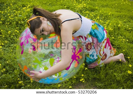 young hippie girl hugging her summer ball
