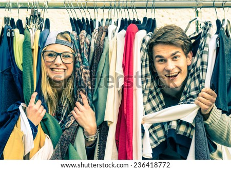 Shutterstock Young hipster couple in love at the weekly flea market - Best friends sharing free time having fun and shopping in the old town - Lovers enjoying everyday life moments on a vintage filtered look