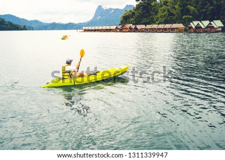 Young hipster enjoy kayaking in lake while summer vacation at floating raft resort in Thailand, Cheow Lan Dam - Sport and Recreations #1311339947