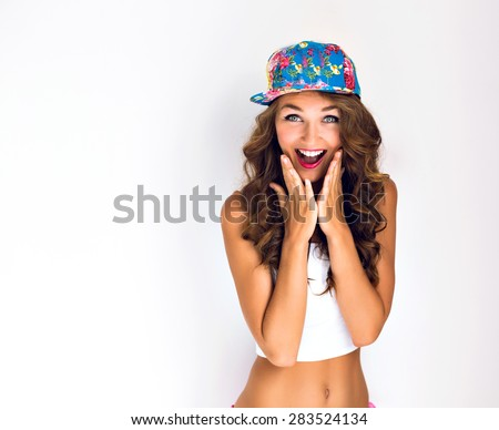Young hipster girl going crazy, have positive surprised emotions, screaming and laughing, bright summer outfit.