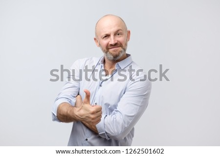 Young hipster man with thumb up