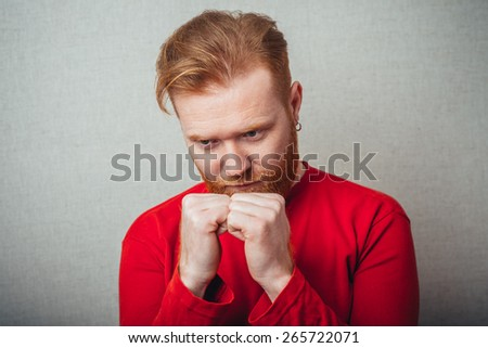 Young hipster red bearded Man with fist on his goatee