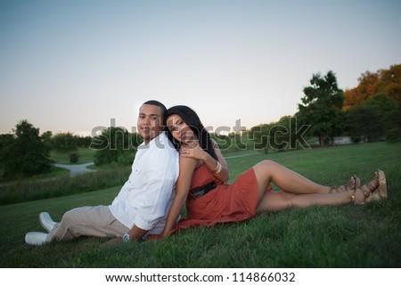 Young Hispanic Couple Engagement Picture Outdoor Portrait