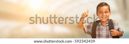 Young Hispanic Male Child Showing Thumbs Up Wearing Backpack with Room For Text. #592342439