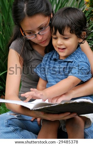 Young Hispanic mother reads a story with her son