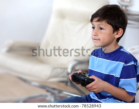 Young Hispanic or Latino boy playing with a video game - with copy space to left