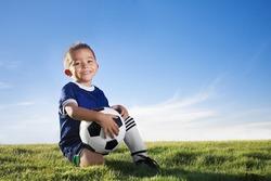 Young hispanic soccer player smiling