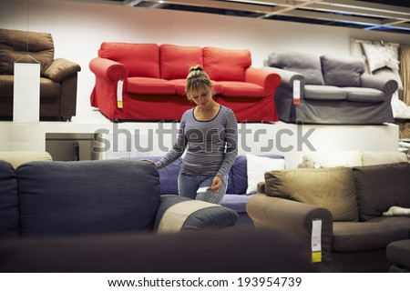young hispanic woman shopping for furniture, sofa and home decor in store #193954739