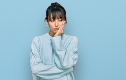 Young hispanic woman wearing casual clothes thinking looking tired and bored with depression problems with crossed arms.