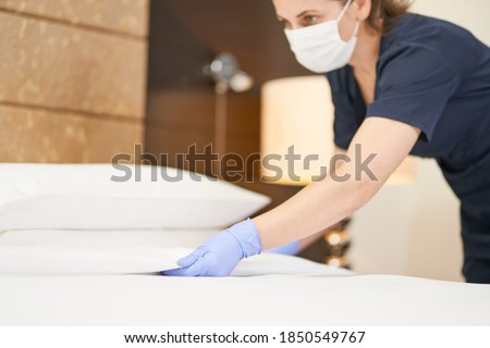 Young housemaid cleaning a luxury hotel room Сток-фото ©