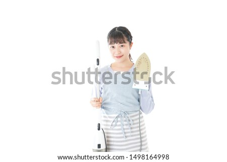 Young housewife doing housework with smile #1498164998