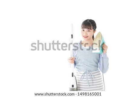 Young housewife doing housework with smile #1498165001