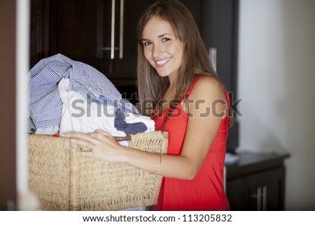 Young housewife doing the laundry