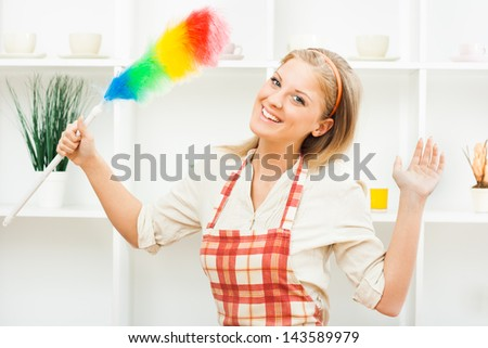 Young housewife is ready for cleaning,Cheerful housewife