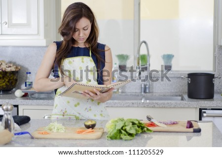 Young housewife making a recipe dish