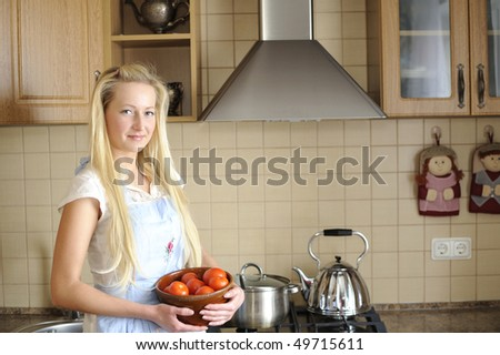 Young housewife posing in kitchen