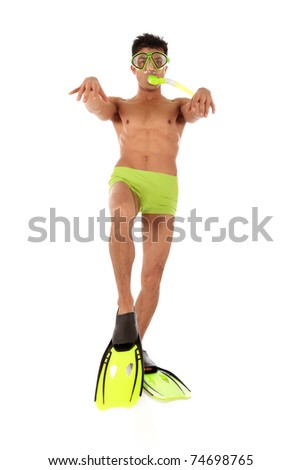 Young humorous Nepalese swimmer male in swimsuit with flippers, goggles and snorkel and with the foot bent in a knee, the arms raised up. Studio shot. White background