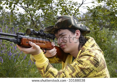 Young hunter shooting up
