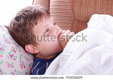 Young ill child coughing in bed