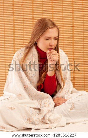 Young ill  woman cough as she got cold and flu - illness strike .