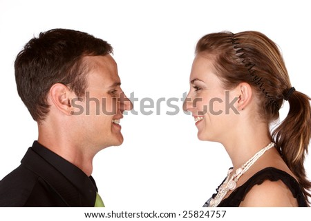 Young in love couple facing each other and smiling laughing - stock photo