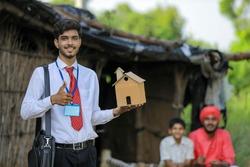 Young indian banker or agronomist visit poor farmer family