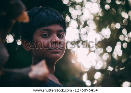 Young Indian boy staring at the camera  #1276896454