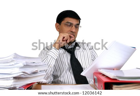 Young Indian business man working at his desk (Series)