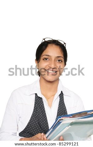 Young Indian business woman, happily holding a pile of files in hand.