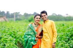 Young indian couple at cotton field