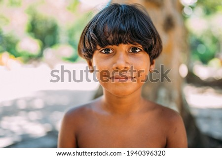young Indian from the Pataxo tribe of southern Bahia. Indian child smiling and looking at the camera. Focus on the face