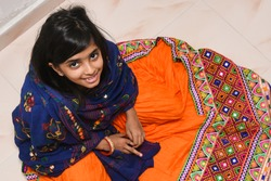 Young Indian girl child wearing colourful traditional ethnic ware Gujarat, India.